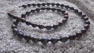 Melni pelēku upes pērļu rota