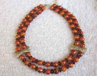Divrindu oranžu akrila pērļu rota