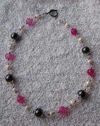 Magnētiskā hematīta un rozā ahāta rota