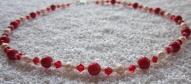 Sarkanu Swarovski kristālu, upes pērļu un koraļļu rota