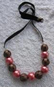 Rota ar samta lentu ar vara krāsas pērlēm